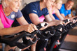 Leinwanddruck Bild - Close Up Of Group Taking Spin Class In Gym