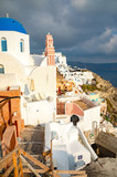 Traditional and famous houses and churches with blue domes in Oia, Santorini, Greece