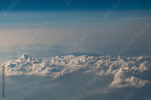 beautiful fluffy clouds from the window of the plane - 234492509