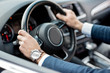 Quadro Close-up of businessman's hands on the helm of a luxury car