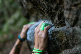 Detail of climber's hands on the rock with band-aid - 234497952