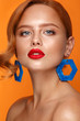 Beautiful girl with unusual accessories and make-up on a bright background. Beauty face. - 234504159
