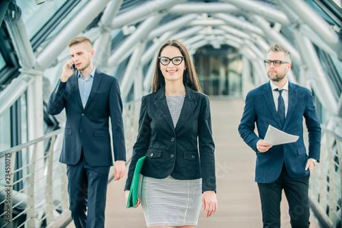 fototapeta na ścianę a group of businessmen on the street