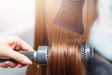 Close-up blow drying for brushing. Salon Spa treatment of keratin straightening and restoration