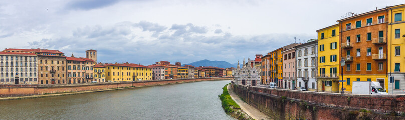 buildings and Arno River in Pisa in Tuscany