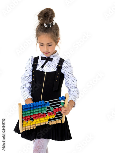 The girl counts on abacus - 234549712
