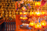 Golden statues of 500 Longhans and offerings in Longhua Buddhist temple.