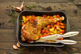 baked turkey thigh with vegetables. - 234624917