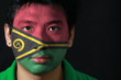 Quadro Portrait of a man with the flag of the Vanuatu painted on his face on black background. The concept of sport or nationalism.