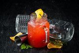 Orange alcoholic cocktail. Orange juice, rum, grenadine, orange. On a wooden background. Top view. Free copy space.