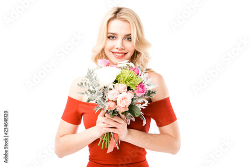Leinwandbild Motiv Happy attractive young woman in red dress holding beautiful flowers isolated on white