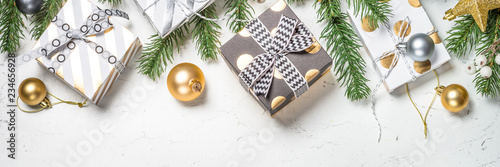 Leinwandbild Motiv Christmas background with Gold and white present box and decorat