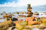 stack of stone tower on the sea beach againt with beautiful blue sky