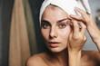 Leinwandbild Motiv Pretty young woman with towel on head