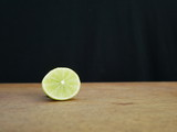 fresh green lime on wooden background
