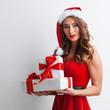 Leinwanddruck Bild - Woman with Christmas gifts