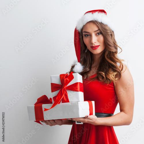 Leinwanddruck Bild Woman with Christmas gifts