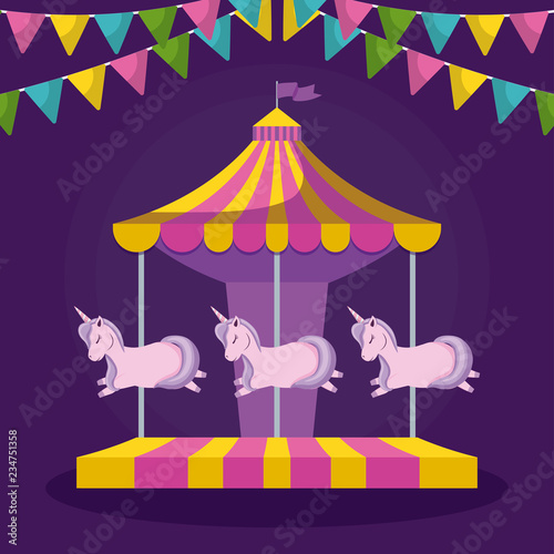 carousel with unicorns and garlands hanging