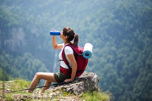 Hiker girl drinking water