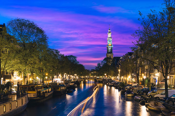 Canals of Amsterdam at night in Netherlands. Amsterdam is the capital and most populous city of the Netherlands.