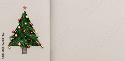 Text or logo empty copy space in vertical top view cardboard with natural eco decorated christmas tree pine.Xmas winter holiday season party social media card background  - 234787337