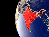 Night view of India from space with visible city lights. Very detailed plastic planet surface.