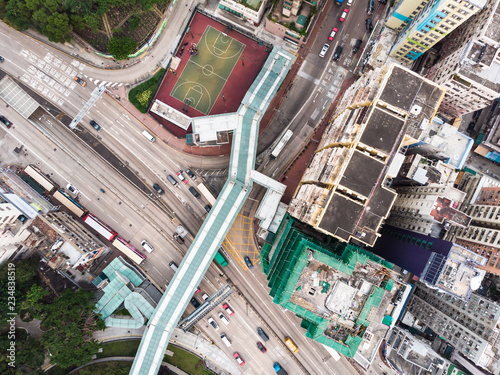 fototapeta na ścianę Straight down view of a foot bridge over a city street in a residential district of Kowloon city in Hong Kong, China
