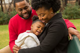 Happy African American family with their baby. - 234839913
