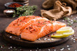 Fresh salmon fish fillet on wooden board