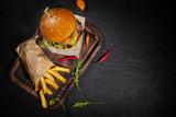 Delicious hamburger, served on stone. - 234844309
