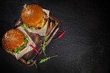 Delicious hamburgers, served on stone. - 234844373