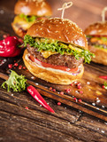 Delicious hamburger with fries, served on wood - 234844535