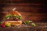 Delicious hamburger, served on wood. - 234844782