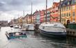 Leinwandbild Motiv Tourist boat goes on Nyhavn, Copenhagen