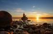 Leinwandbild Motiv hübsche junge frau macht yoga auf einem Stein im Wasser See Meer im Sonnenuntergang Abendrot