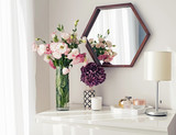 Light room with mirrow, flowers, night lamp and other objects - 234885380