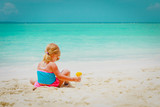 sun protection at beach- little girl with sunblock cream on shoulder