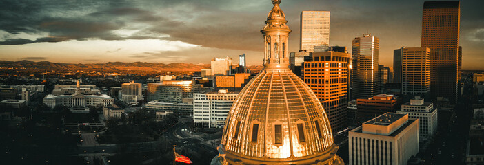 Aerial drone photo - Sunrise over the golden Colorado State Capitol Building.  Denver