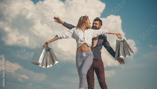 Leinwandbild Motiv Spring shopping. Couple happy shopping. Shopping bags and sale.