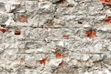 A fragment of a wall of concrete blocks, along which cracks went. - 234977310