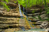 Waterfall in mountain of Caucasus. Summer landscape with waterfall and waterstream in forest of Caucasus mountain.