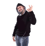 stylish guy rapper showing the OK gesture . isolated on white