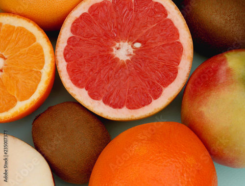 citrus fruits on a colored background close up - 235007378