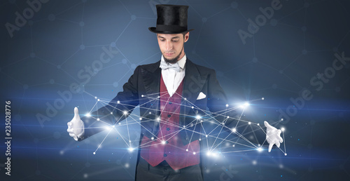 Leinwanddruck Bild Magician with blue background and geometrical connection between two hands
