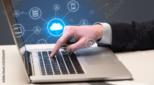 Leinwanddruck Bild Businessman hand typing with cloud technology system and office symbol concept