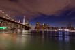 Manhattan skyline and Brooklyn Bridge by night