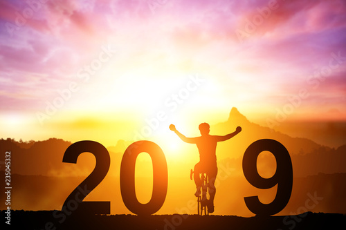 Silhouette bicycle in 2019 text on sunset,Friendship in bicycle sport.happy new year