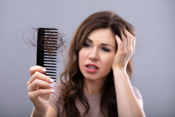 Worried Woman Suffering From Hairloss