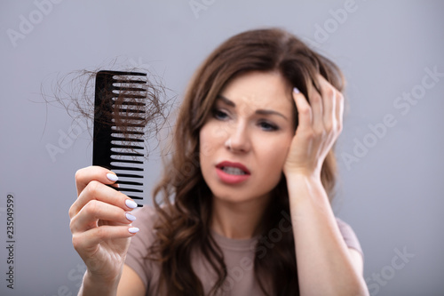 Worried Woman Suffering From Hairloss - 235049599