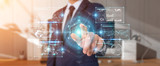 Businessman using digital screens interface with holograms datas 3D rendering - 235088564